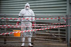 Bio hazard worker on farm Stock Photos