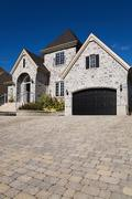 Large house and driveway - stock photo