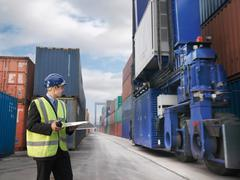 Businessman With Shipping Containers Kuvituskuvat