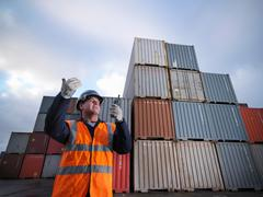 Port Worker With Shipping Containers Kuvituskuvat