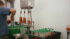 Filling bottles with fresh organic juice on the farm, Stock Footage