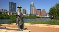 Stevie Ray Vaughan Sculpture in Front of Downtown Austin, Texas & Colorado River Stock Footage