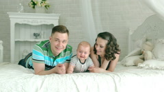 Mom dad and 6 month old baby. Happy family playing with an infant. Stock Footage