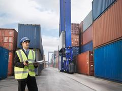 Businessman With Shipping Containers Stock Photos