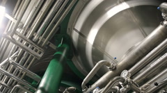 Pipes at a beer plant Stock Footage