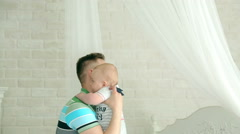 Dad plays with the baby. The happy father. Father and son having fun. Arkistovideo