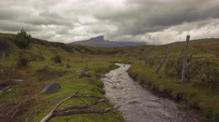 Time-lapse looking along a mountain stream running with glacial meltwater Stock Footage