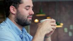 Man drinking coffee in trendy coffee shop Stock Footage