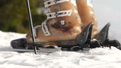 Skier Attaching Ski Boots To Carving Skis And Setting Off To Skiing Stock Footage