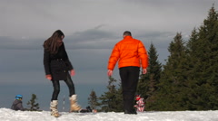 Love story shot of a couple playing in a sunny winter day scene Stock Footage