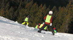 Ski slope Landscape with Children skiing in winter scene Stock Footage