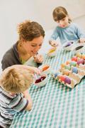 Family doing Easter arrangements Stock Photos