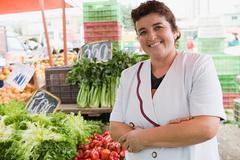 Woman trader at vegetable stall Stock Photos