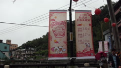Posters promoting the chinese lantern festival on the streets of Pingxi, Taiwan Stock Footage