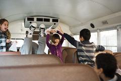 Children having fun on school bus Stock Photos