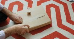 Man unboxing cardboard box - stock footage