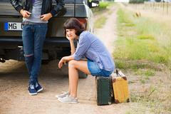 Couple waiting by suv Stock Photos