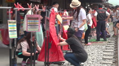 People is writing their Chinese lanterns during the Lantern Festival Stock Footage