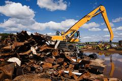 Metal and machine in scrap yard Stock Photos