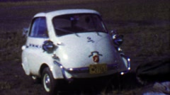 1957: BMW Isetta white mini car Native Baptist Missionary. - stock footage