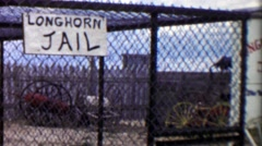 1959: Longhorn Jail kid pretending locked up behind bars. Stock Footage