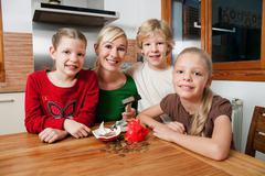 Family smash open a piggy bank Stock Photos