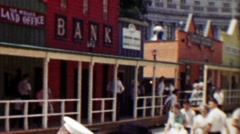 1959: Old west recreation town replica bank mainstreet crowds gather. - stock footage