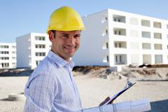Architect on construction site Stock Photos