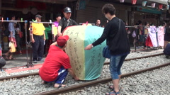 People preparing and launching chinese lanterns during the Lantern Festival Stock Footage