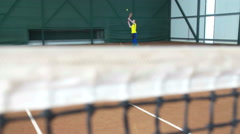 Steadycam shot of young beautiful woman professional tennis player on field Stock Footage