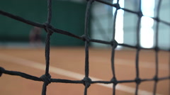 Steadycam shot of young professional tennis player on field Stock Footage
