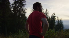 Athlete takes a breather and takes in the view while in the mountains. Stock Footage