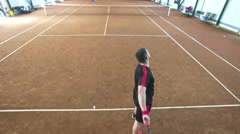 Overhead angle Crane shot of young professional tennis player serve Stock Footage