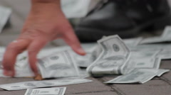 Person collecting dollar banknotes from the ground, easy money, fraud, scam Stock Footage