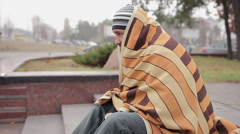 Lonely homeless man covered with shabby blanket feeling cold, asking for money Stock Footage