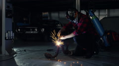 Mechanic welding car parts. Stock Footage