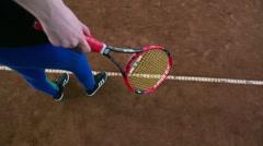 Overhead angle Crane shot of young girl playing tennis Stock Footage