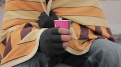 Hands of kind people giving charity money to homeless beggar, closeup shot Stock Footage