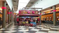 4K Lowes Cinema movie theatre entrance Stock Footage