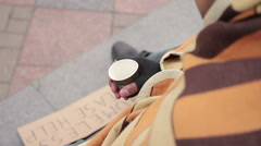 Poor person begging for charity in city street, sympathetic people giving money Stock Footage