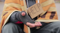 Begging hand of homeless poor person asking for help, people donating money Stock Footage