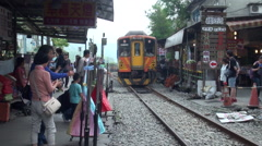 Train entering a station of Pingxi, Taiwan Stock Footage