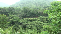 Train passing by the mountains Pingxi in Taiwan, with lots of greenery Stock Footage