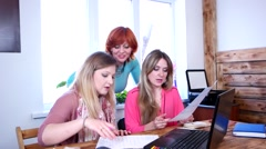 Team of business women with laptop discuss working moments in the planning. Stock Footage