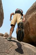 Man hiking in rocky terrain Stock Photos