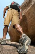 Man hiking in rocky terrain - stock photo