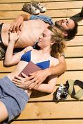 Couple enjoying lakeside vacation Stock Photos