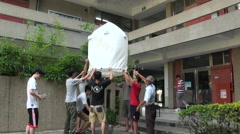 Students preparing ecologial Chinese lantern, Taichung, Taiwan Stock Footage