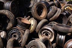 Scrap car tires and rims - stock photo