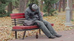 Disgusting drunk man sleeping and coughing on bench in city park, alcohol addict Stock Footage